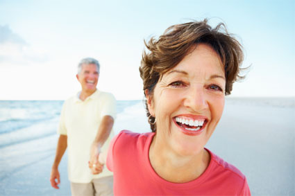 Closeup of a cheerful retired couple having a good time on a beach